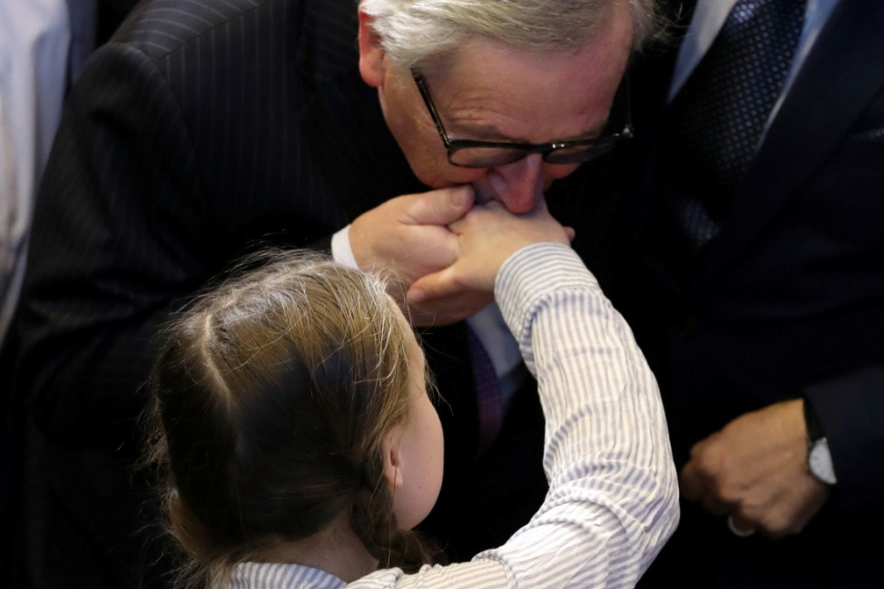 European Commission President Jean-Claude Juncker kisses the hand of 16-year old Swedish environmental activist Greta Thunberg at a conference