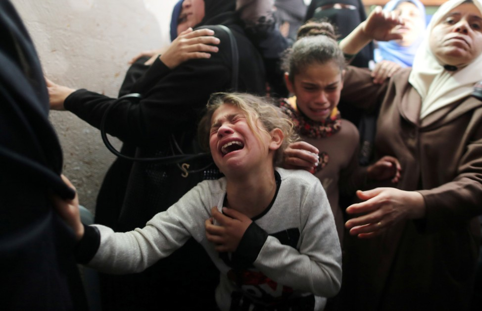 Relative of Palestinian teenager Yousif al-Dayyah, 15, mourns during his funeral in Gaza City