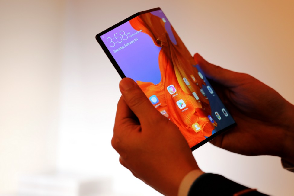 A member of Huawei staff shows the new Huawei Mate X device during a pre-briefing display ahead of the Mobile World Congress in Barcelona