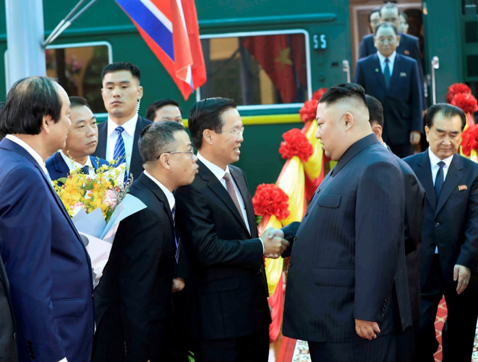North Korea's leader Kim Jong Un greeted by Vietnam's Communist Party's Politburo member Vo Van Thuong upon his arrval  at the border town with China in Dong Dang