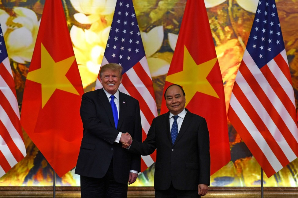 U.S. President Donald Trump shakes hands with Vietnamese Prime Minister Nguyen Xuan Phuc at the Government office, ahead of the second U.S.-North Korea summit, in Hanoi