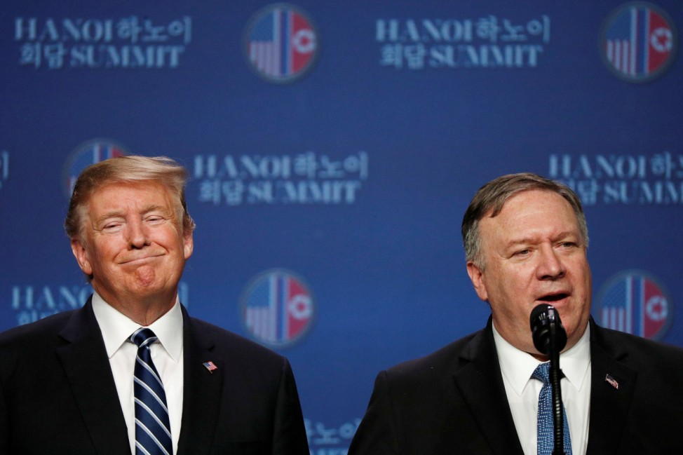 U.S. Secretary of State Mike Pompeo speaks next to U.S. President Donald Trump during a news conference after Trump's summit with North Korean leader Kim Jong Un, at the JW Marriott Hotel in Hanoi