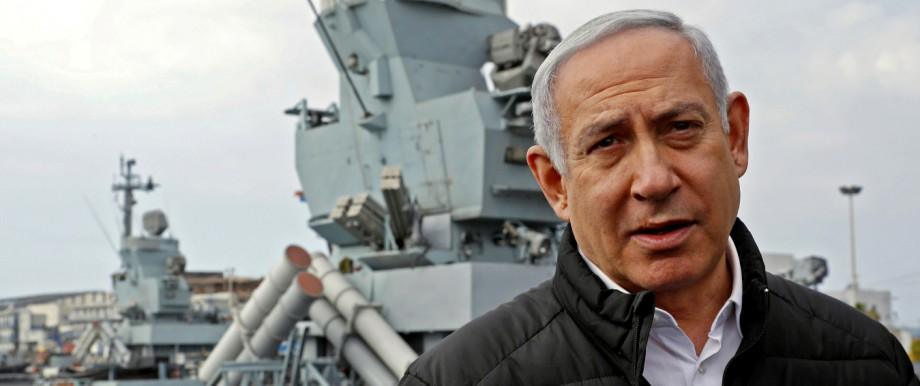 Israeli Prime Minister Benjamin Netanyahu gives a statement during his visit to a navy base in Haifa