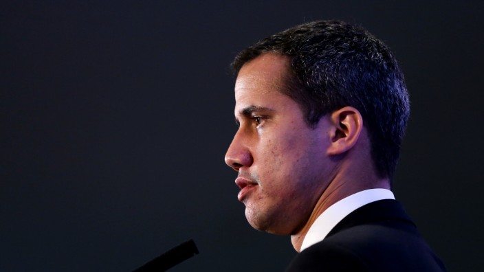 Venezuelan opposition leader Juan Guaido, who many nations have recognized as the country's rightful interim ruler, gestures during a news conference at the San Martin Palace in Buenos Aires