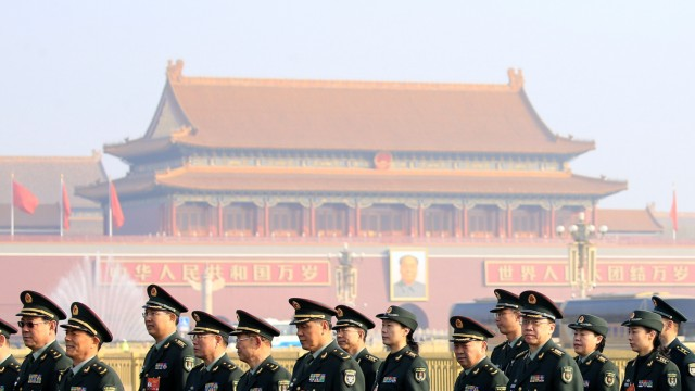 Military delegates arrive at the Great Hall of the People for a meeting ahead of National People's Congress (NPC), China's annual session of parliament, in Beijing