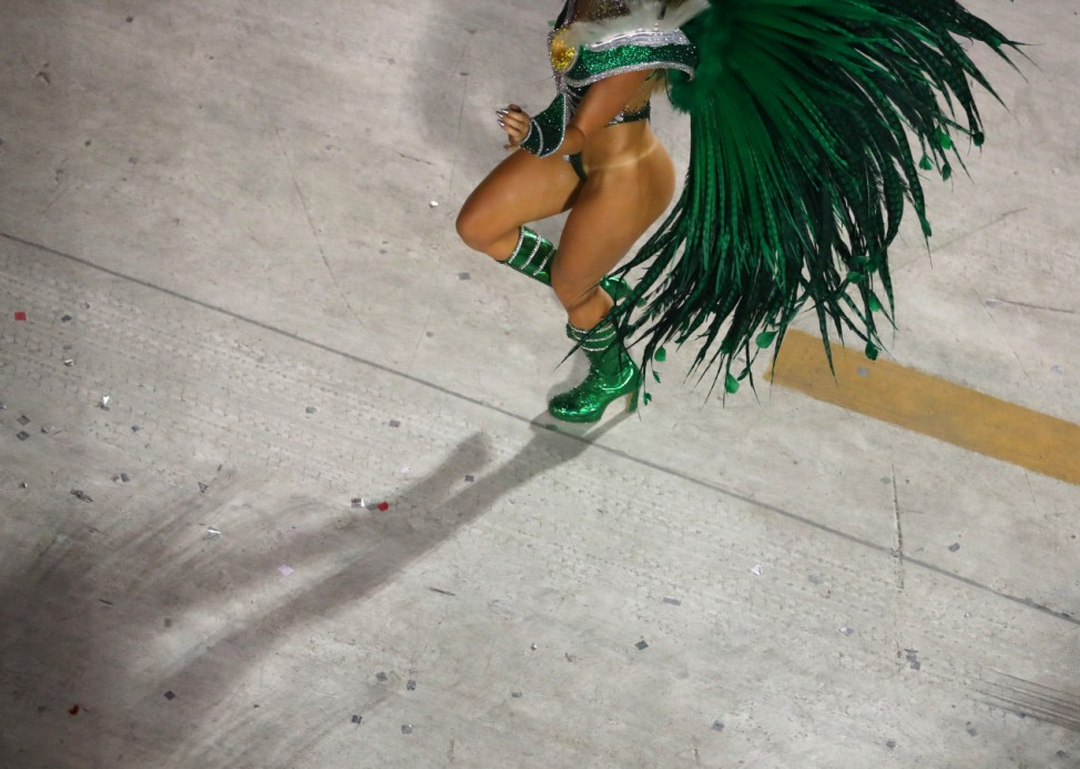 Reveller from Grande Rio samba school performs during the first night of the Carnival parade in Rio de Janeiro