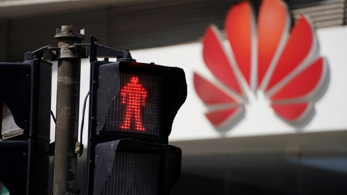 A Huawei company logo is seen outside a shopping mall in Shanghai