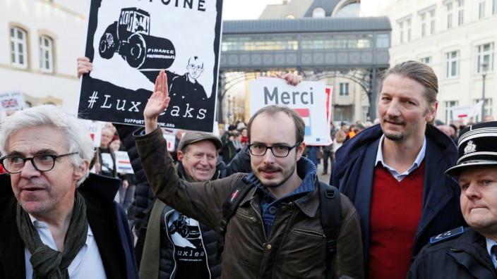 Former PricewaterhouseCoopers employee Antoine Deltour is escorted by police as he arrives for the LuxLeaks trial before an appeal court in Luxembourg