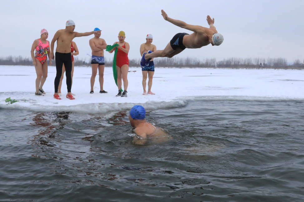 Winter swimmers enjoy swimming in the icy Songhua River in Harbin, Heilongjiang