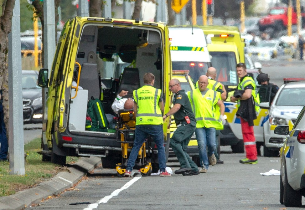 An injured person is loaded into an ambulance following a shooting at the Al Noor mosque in Christchurch
