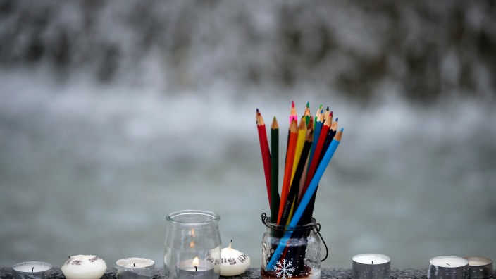 FILE PHOTO - Pencils are seen near candles as several thousand people gather to pay tribute to the victims following a shooting by gunmen at the offices of the satirical weekly newspaper Charlie Hebdo during a demonstration in Nantes