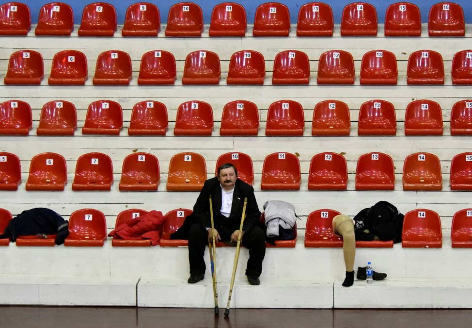 A spectator watches a regional championship among wheelchair basketball teams in the far eastern city of Vladivostok