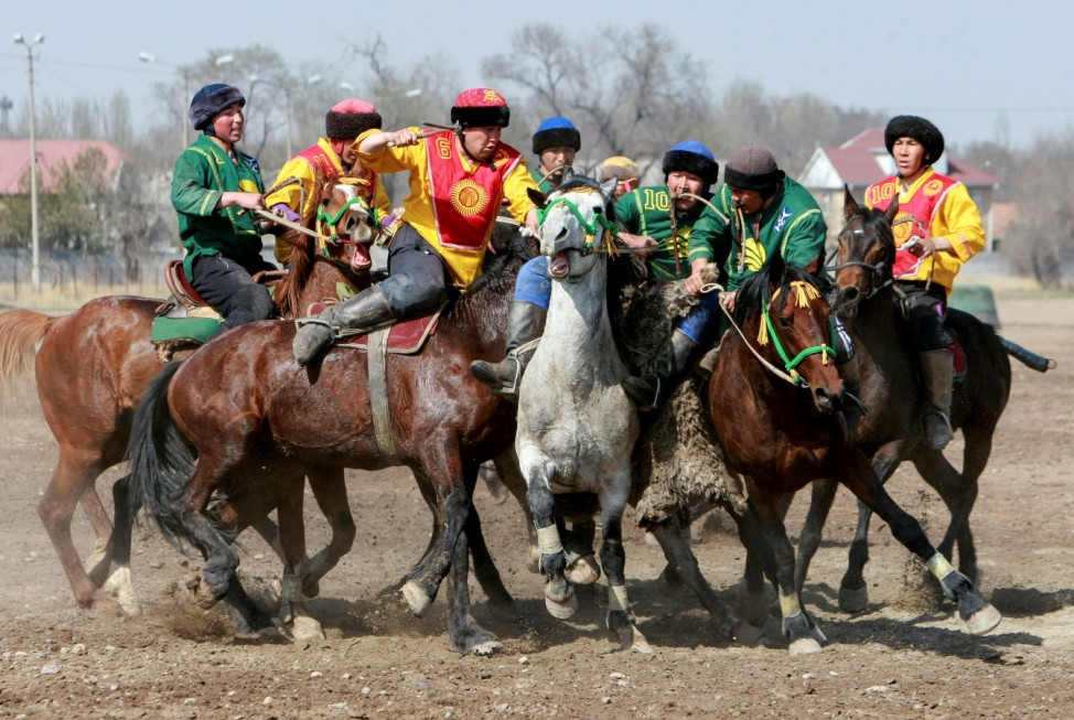 Horsemen take part in a Kok-boru, or goat dragging, competition as part of Navruz celebrations, an ancient holiday marking the spring equinox, in Bishkek