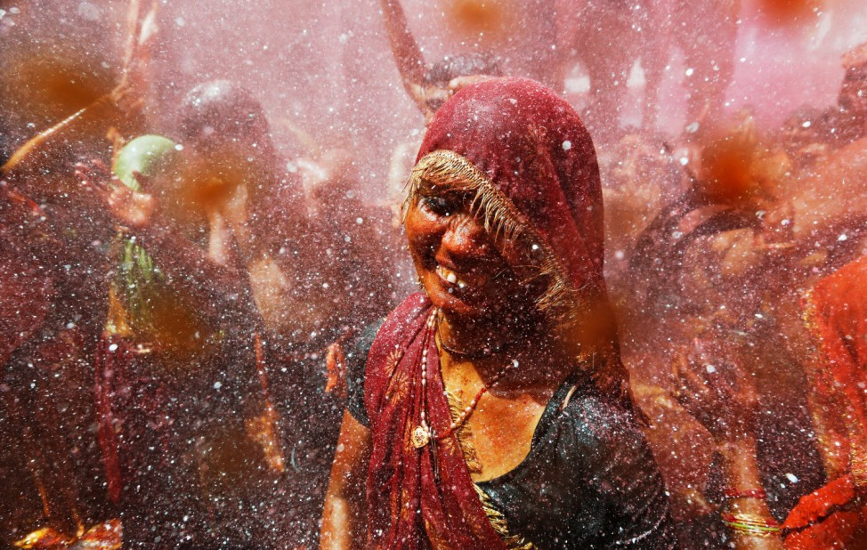 A woman takes part in Huranga, a game played between men and women a day after Holi, at Dauji temple
