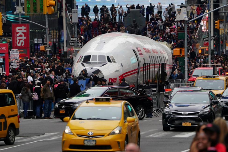 The fuselage of a TWA plane is pictured parked in Times Square before being brought to JFK airport to be used a cocktail lounge in New York