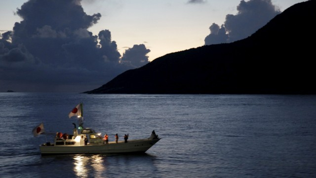 File photo of a fishing boat sailing around a group of disputed islands known as Senkaku in Japan and Diaoyu in China in the East China Sea