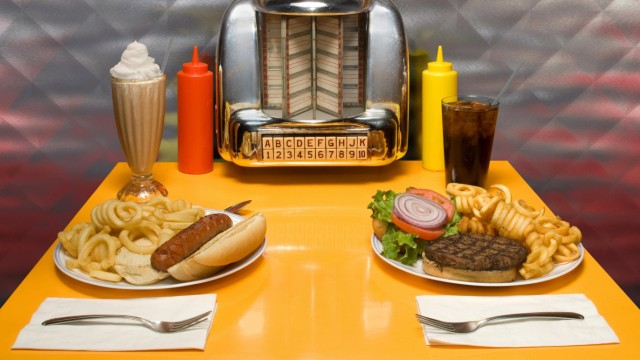 1950 s style diner table with juke box malt cola hot dog and hamburger ISTOCK THE SONG TITLES A