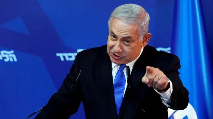 FILE PHOTO: Israel's Prime Minister Benjamin Netanyahu gestures as he speaks during a news conference in Jerusalem