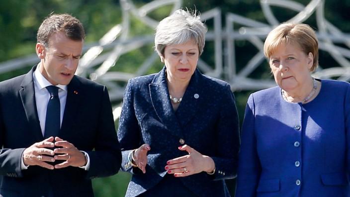 May trifft Merkel und Macron