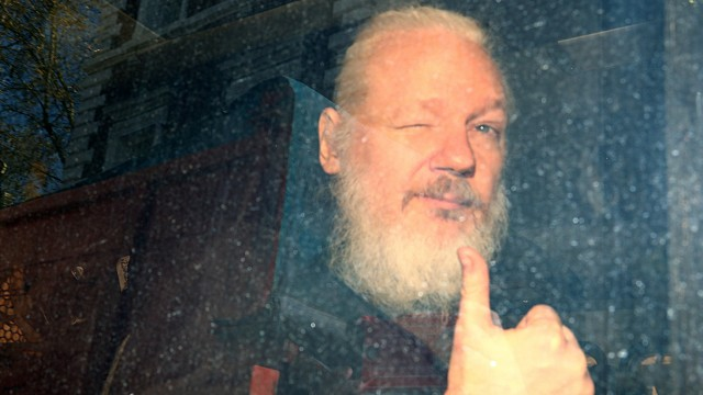 Julian Assange arrives at the Westminster Magistrates Court, after he was arrested  in London