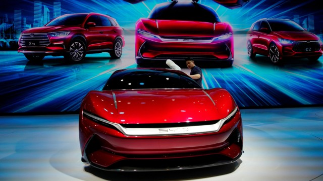 Man cleans a BYD e-SEED GT concept EV during the media day for the Shanghai auto show in Shanghai