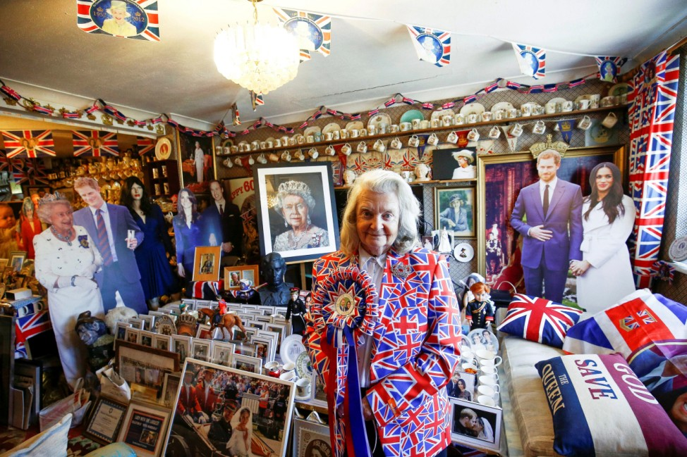 Royal fan Margaret Tyler poses inside her home, which is adorned with thousands of pieces of Royal Family memorabilia, in north London