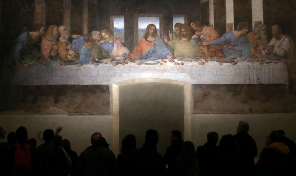 Visitors look at ' The Last Supper' Leonardo da Vinci's masterpiece on a refectory wall of the church of Santa Maria delle Grazie in Milan