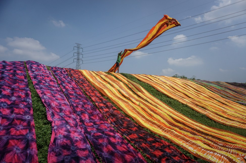 A worker throw a cloth during a drying process at Sukoharjo near Solo, Central Java province