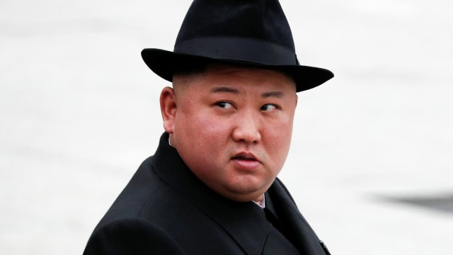 North Korean leader Kim Jong Un looks on after attending a wreath laying ceremony at a navy memorial inVladivostok