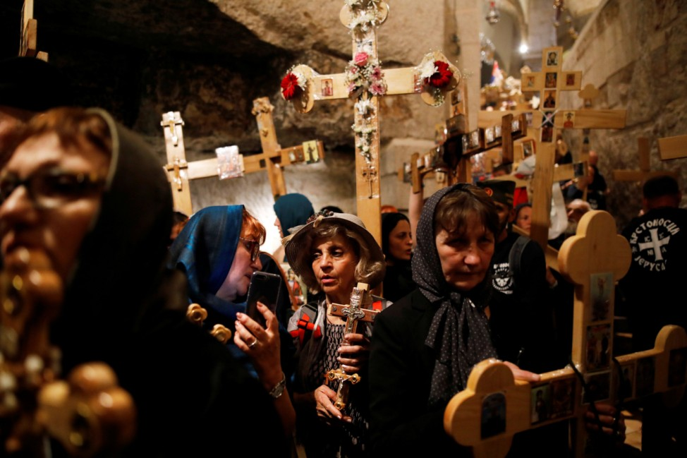 Orthodox Christian worshippers take part in the Good Friday services in the Church of the Holy Sepulchre in Jerusalem's Old City