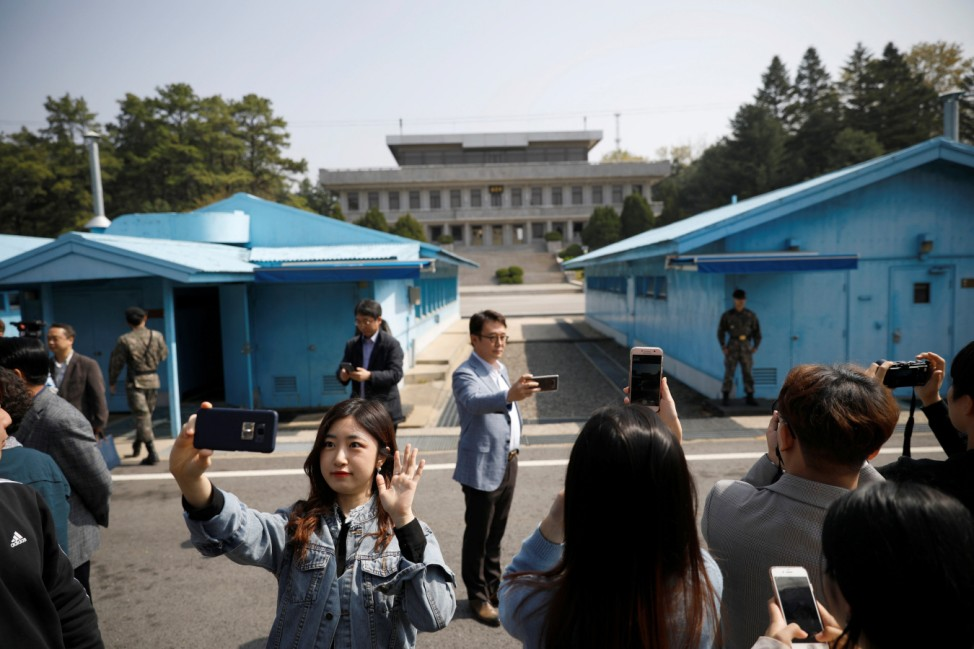 South Koreans take selfies as they tour the truce village of Panmunjom