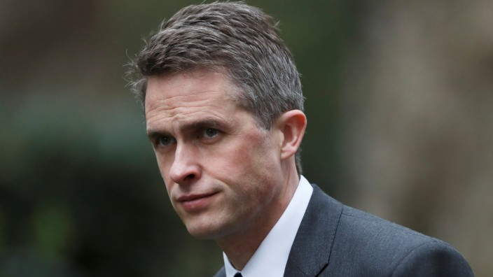 FILE PHOTO: Britain's Defence Minister Gavin Wiliamson is seen outside Downing Street in London