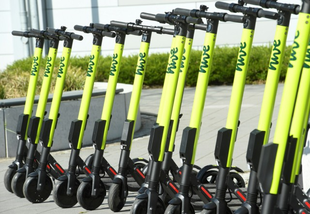 E-scooters are lined up during a presentation at the DESY campus in Hamburg