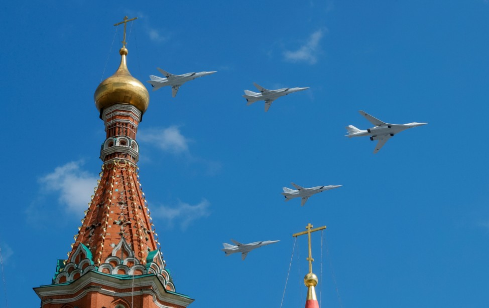 Russian army Tupolev Tu-160 and Tupolev Tu-22M3 fly in formation over St. Basil's Cathedral during the rehearsal for the Victory Day parade in Moscow