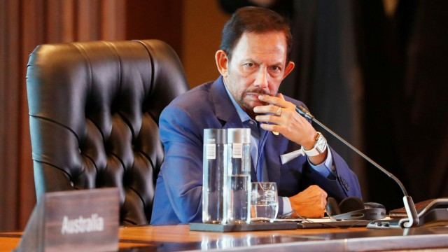 FILE PHOTO: Brunei's Sultan Hassanal Bolkiah attends the retreat session during the APEC Summit in Port Moresby, Papua New Guinea
