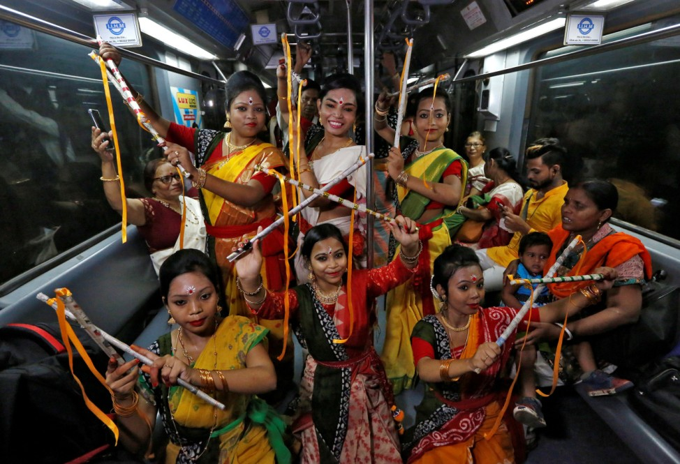 Women, who according to the organisers are suffering from Thalassaemia, perform inside a running Metro train to celebrate the 158th birth anniversary of Nobel Prize winning poet Rabindranath Tagore in Kolkata