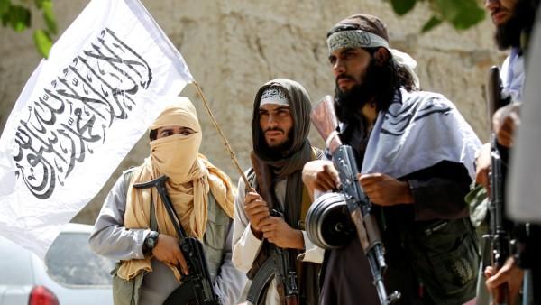 FILE PHOTO: Taliban walk as they celebrate ceasefire in Ghanikhel district of Nangarhar province, Afghanistan