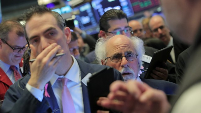 Traders work on floor as Uber Technologies Inc. holds IPO at NYSE in New York