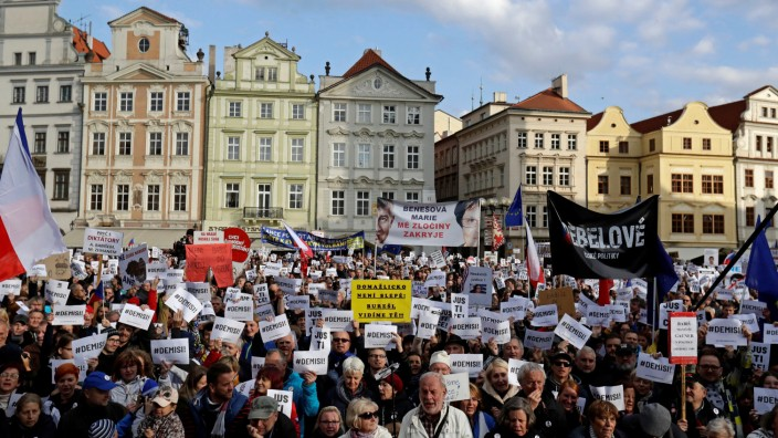 Demonstrators hold banners during a protest rally demanding resignation of Czech Prime Minister Andrej Babis in Prague