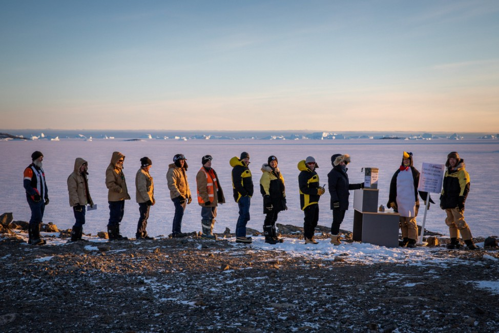 A supplied image of expedition members as they line up to vote at Davis research station, Antarctica