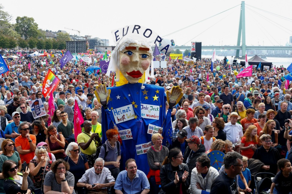 People attend the 'No to Hate, Yes to Change' pro-European demonstration, ahead of the EU election