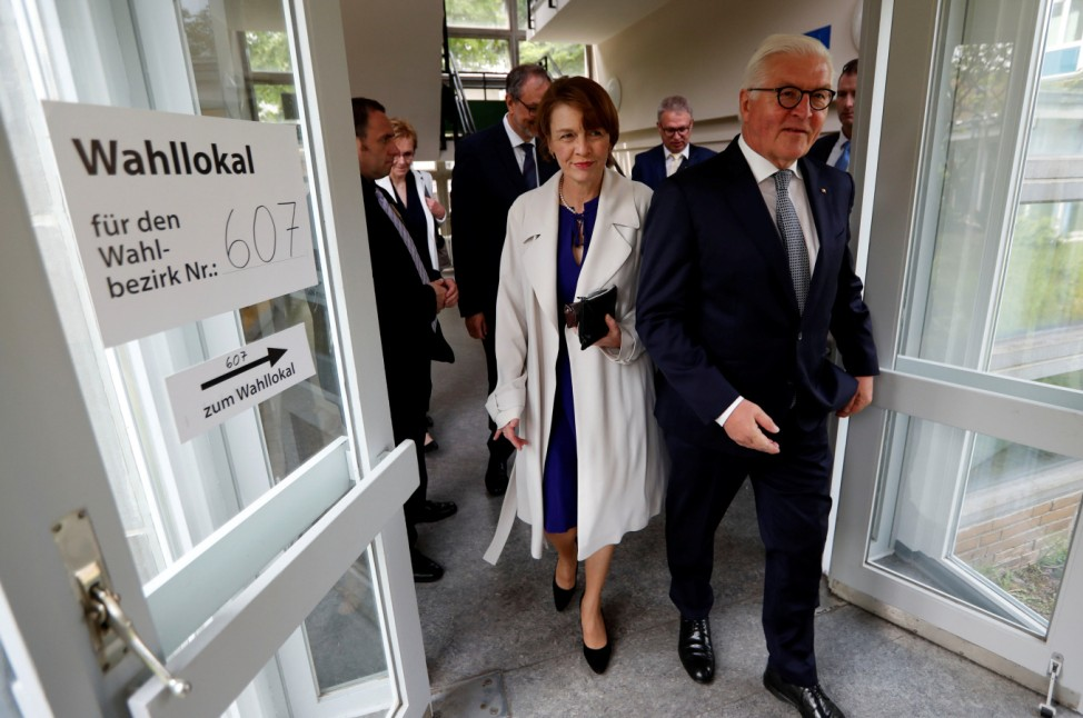German President Frank-Walter Steinmeier and his wife Elke Buedenbender leave a polling station after they cast their votes for the European Parliament elections in Berlin