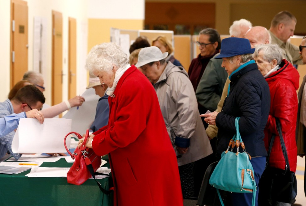 People arrive to cast their votes during the European Parliament Elections in Sopot