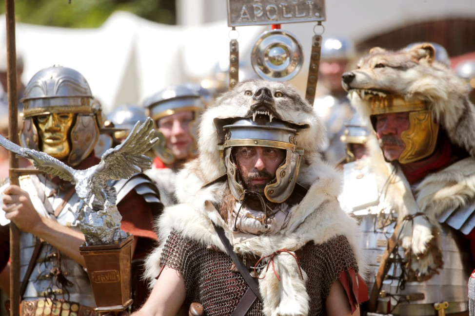 Participants dressed as Roman legionnaires perform during the 'Roemisches Heerlager' reanactment event in Windisch