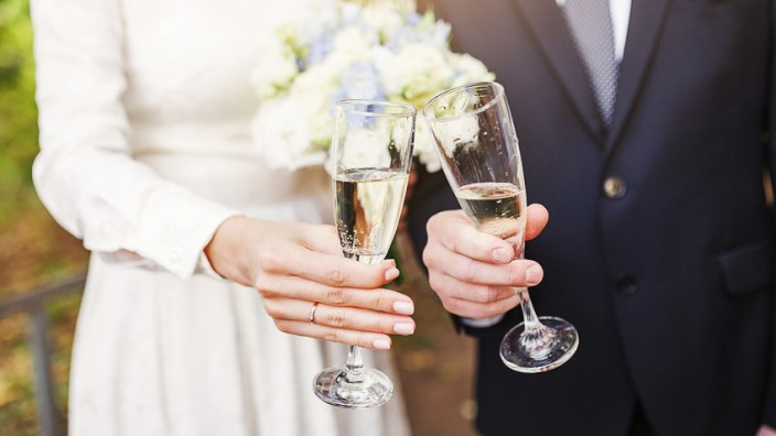 Groom and bride Toast and clinking glasses at the wedding party; Toast