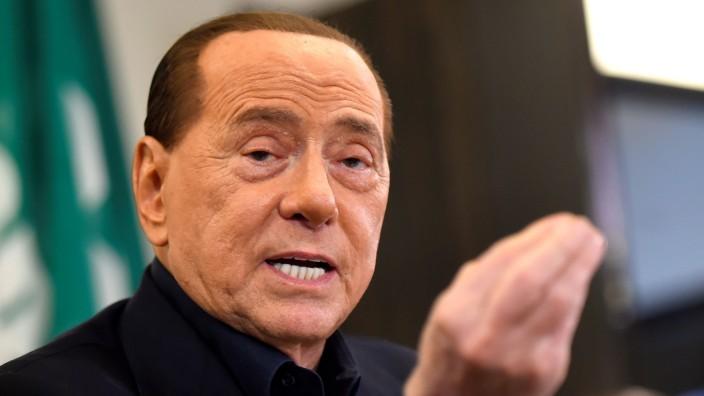Former Prime Minister Silvio Berlusconi attends a news conference in support of Forza Italia EU parliamentarian Alberto Cirio, in Turin