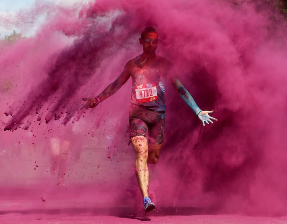 A participant runs through coloured powder during the Colour Run race in Moscow