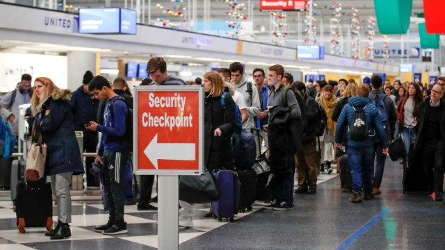 FILE PHOTO: Travelers go through O'Hare International Airport before the Thanksgiving Day holiday in Chicago
