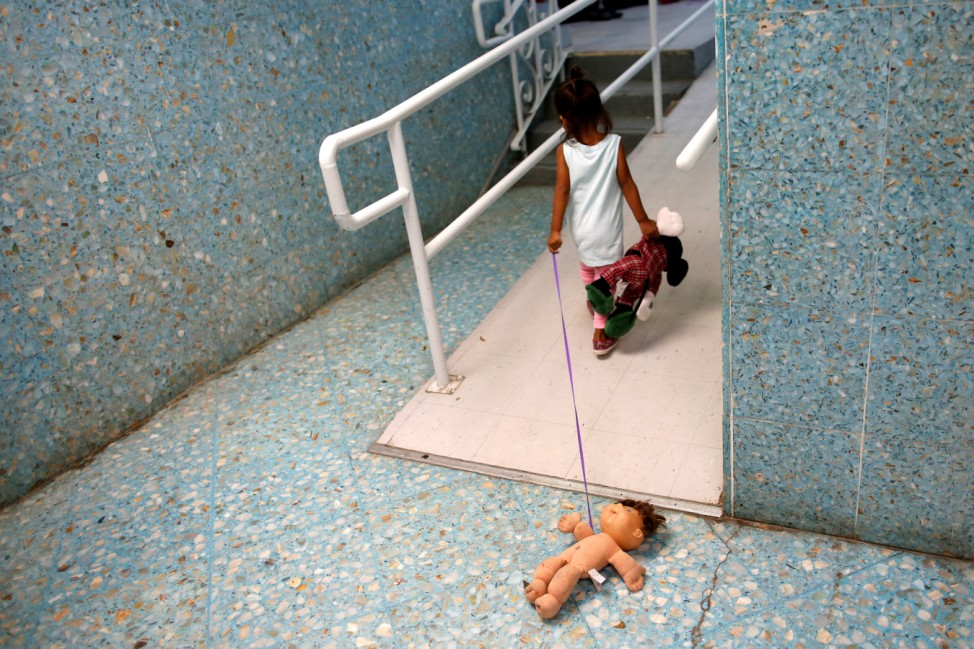 A Central Americans child plays on a hallway of the Catholic shelter 'San Francisco Javier Church' in Laredo
