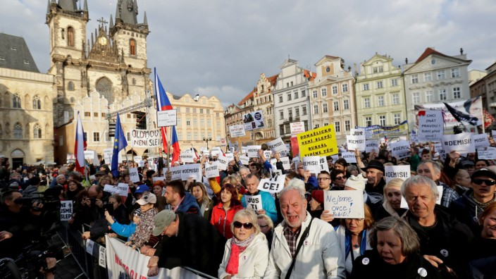 FILE PHOTO: Demonstrators hold banners during a protest rally demanding resignation of Czech Prime Minister Andrej Babis in Prague